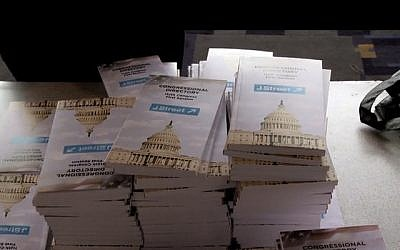 People pick up J street lobbying material during a conference in Washington DC (image capture: J Street: The Documentary trailer)