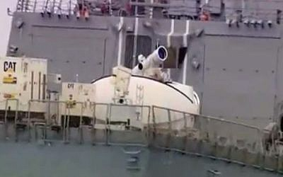 The LaWS anti-drone laser weapons system mounted on the USS Dewey in 2012 (photo credit: Youtube screen capture)