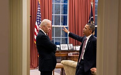 Barack Obama, right, speaking with Joe Biden in the Oval Office in March. (photo credit: Pete Souza/Official White House)