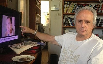 Nahum Shahaf at work in his study (photo credit: Mitch Ginsburg/Times of Israel)