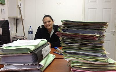 Lt. Arin Shaabi in her folder-filled office (Photo credit: Mitch Ginsburg/ Times of Israel)