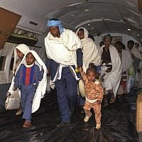 New Ethiopian immigrants boarding an aircraft en route from Addis Ababa to Israel during Operation Solomon, 1991. (Natan Alpert/GPO)