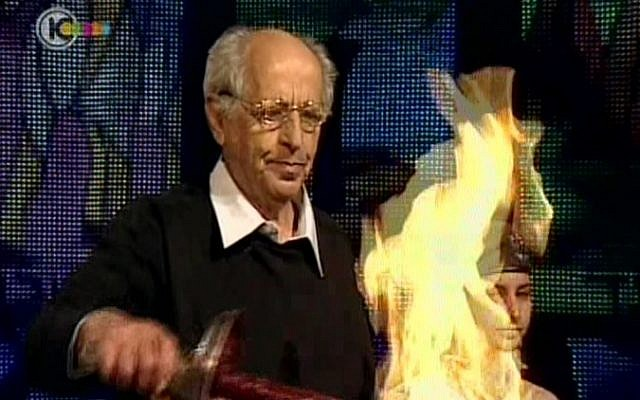Muki Tzur lights the first torch at Monday night's Independence Day ceremony at Mt. Herzl in Jerusalem. (photo credit: image capture Channel 10)