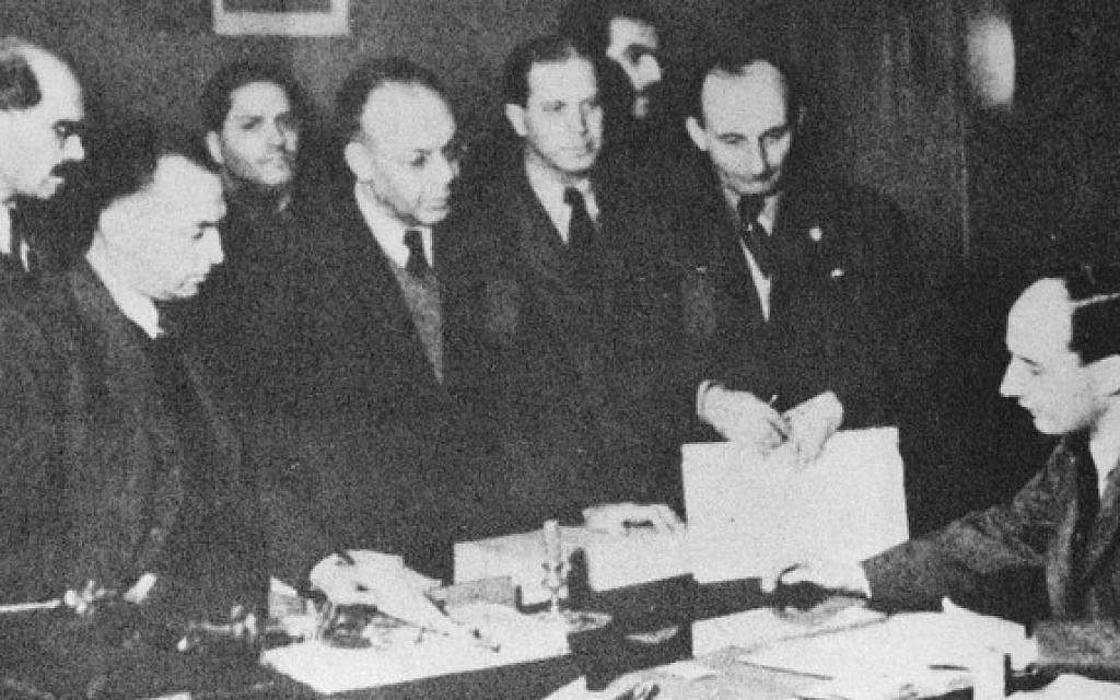 Raoul Wallenberg, right, with Jews in the Swedish Embassy in Budapest, exact date uncertain (Courtesy Yad Vashem)