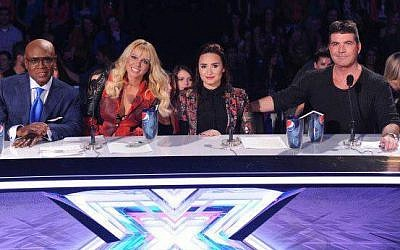 A recent panel of 'X-Factor' judges, including L.A. Reid, Britney Spears, Demi Lovato and Simon Cowell (Courtesy 'The X-Factor Israel' Facebook page)