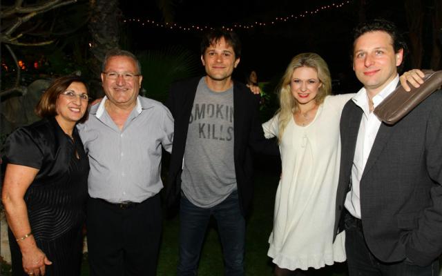 Yariv Horowitz (center) and friends at a Maimouna party in Caesarea (Courtesy Yariv Horowitz Facebook)