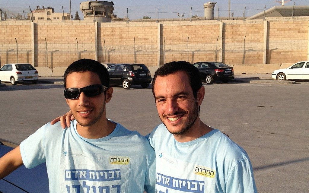 Matan Asher, right, and Alon Begin at the Qalandiya checkpoint, April 30 (photo credit: Elhanan Miller/Times of Israel)