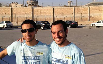 Matan Asher, right, and Alon Begin at the Qalandiya checkpoint, April 30 (photo credit: Elhanan Miller/Times of Israel)