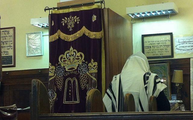 An illustrative photo of a man praying at a synagogue. (photo credit: Aaron Kalman)
