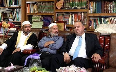Sheikh Omar Kayal, imam of the Bilal mosque (right), sits with Israeli Muslim clerics at a reception for French Imam Hassen Chalghoumi in Majd Al-Krum, May 29 (photo credit: Elhanan Miller/Times of Israel)
