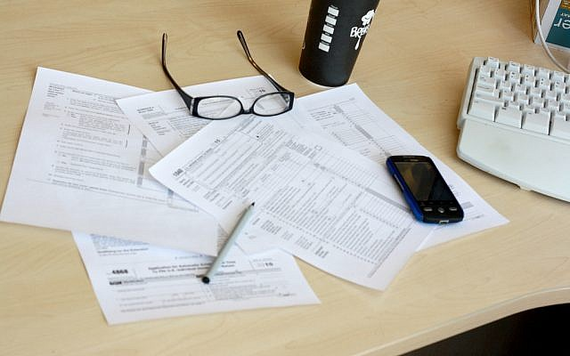 Tax forms. (photo credit: CC BY Moneyblognewz, Flickr)