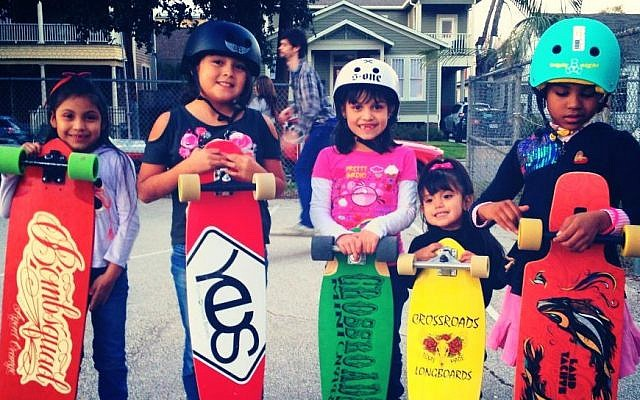 Houston kids at a spring Longboarding for Peace event. Six of the 20 kids involved in the previous LB4P project were rival gang members who came together and put down their guns. (photo credit: Andrea Wallace)