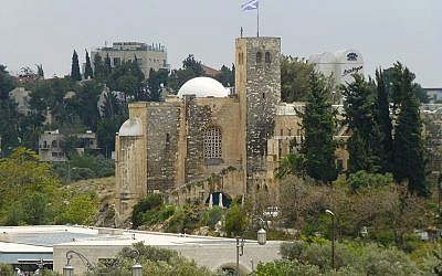 St. Andrew's Church in Jerusalem, with the Scottish flag fluttering above. (photo credit: CC BY paularps, Flickr)