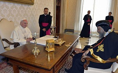 Pope Francis, left, and Coptic Orthodox Church of Egypt Pope Tawadros II meet during their private audience in the pontiff's library, at the Vatican, on Friday (photo credit: AP/Andreas Solaro)