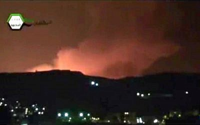 A screenshot showing smoke and fire filling the skyline over Damascus, Syria, early Sunday. (photo credit: AP/Ugarit News)