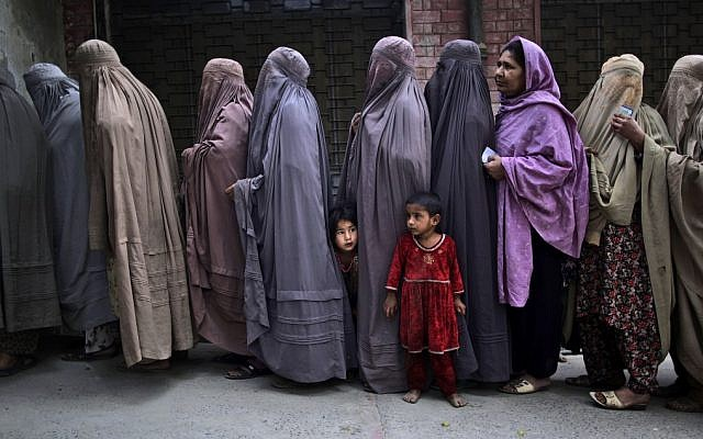 Illustrative: Pakistani women at a polling station on the outskirts of Islamabad, Pakistan, May 2013. (AP Photo/Muhammed Muheisen)