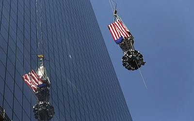 The final piece of the spire is hoisted to the roof of One World Trade Center in New York, Thursday, May 2 (photo credit: AP/Mark Lennihan)