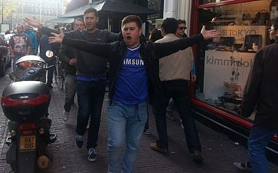 Adam Green with fellow British fans of the English soccer club Chelsea on their way to a match in Amsterdam, May 15, 2013. (photo credit: Cnaan Liphshiz/JTA)