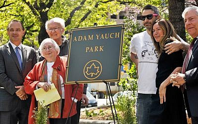 Noel and Frances Yauch, second from left, and former Beastie Boys member Adam Horovitz and wife Rachael, with New York City and Brooklyn officials standing by the plaque marking Adam Yauch Park in Brooklyn, May 3, 2013. (Daniel Zuchnik/Getty/via JTA)