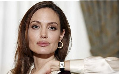 Actress Angelina Jolie authored an op-ed for Tuesday's May 14, 2013, New York Times, where she writes that in April she finished three months of surgical procedures to remove both breasts as a preventive measure. (photo credit: AP/Carlo Allegri, File)