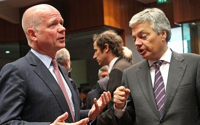 British Foreign Secretary William Hague, left, talks with Belgium's Foreign Minister Didier Reynders, during the EU foreign ministers meeting, at the European Council building in Brussels, May 27, 2013. (photo credit: AP/Yves Logghe)