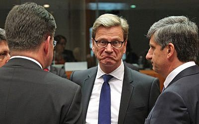 German Foreign Minister Guido Westerwelle, center, listens to Austrian Foreign Minister Michael Spindelegger, right, and other counterparts, during the EU foreign ministers meeting, at the European Council building in Brussels, on Monday, May 27, 2013. (photo credit: AP Photo/Yves Logghe)