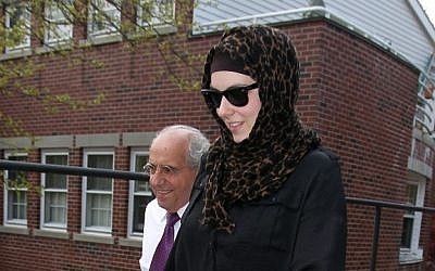 Katherine Russell, wife of Boston Marathon bomber suspect Tamerlan Tsarnaev, leaves the law office of DeLuca and Weizenbaum with Amato DeLuca, left, Monday, April 29, in Providence, R.I. (photo credit: AP/Stew Milne)