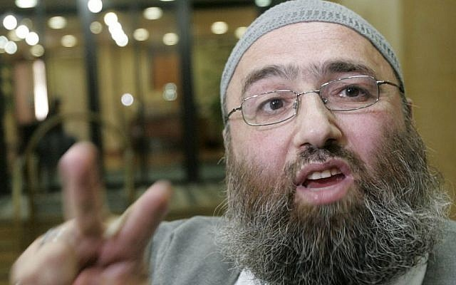 In this Sept. 5, 2005 photo, Muslim cleric Omar Bakri Mohammed gestures while talking to the media, in Beirut, Lebanon. (photo credit: AP Photo/Hussein Malla)