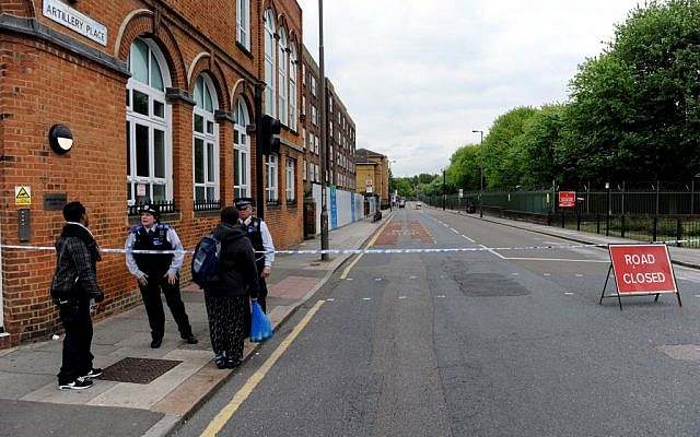 The scene where British officials said one person has died and at least two people have been wounded in an attack on Wednesday May 22, 2013. (photo credit: AP Photo/Nick Ansell/PA)