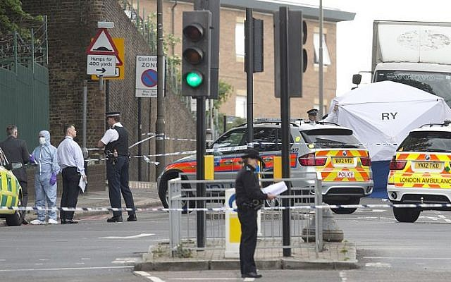 Police and forensic officers near the scene of a terror attack near Woolwich barracks in London, May 22, 2013. (AP/Alastair Grant)