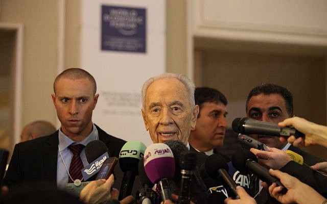 President Shimon Peres gives a brief statement at the World Economic Forum, in Southern Shuneh, 34 miles (55 kilometers) southeast of Amman, Jordan, Sunday, May 26, 2013 (photo credit: AP/Mohammad Hannon)