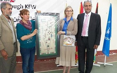 UNRWA's Ann Dismorr (second from right) holds the Israel-less map. (photo credit: screen capture/pn-news.net)