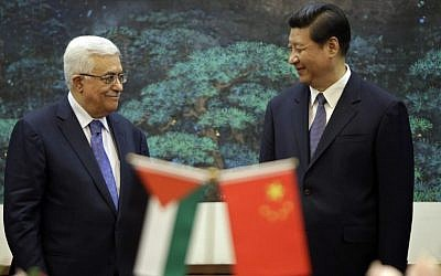 China's President Xi Jinping (right), and his Palestinian counterpart, Mahmoud Abbas, attend a signing ceremony at the Great Hall of the People in Beijing, China. (photo credit: AP/Jason Lee)