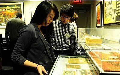 Bronx Science sophomores Theresa Wang and Justin Wu examine artifacts at the school's Holocaust Museum and Studies Center. (photo credit: Courtesy of Bronx Science High School)