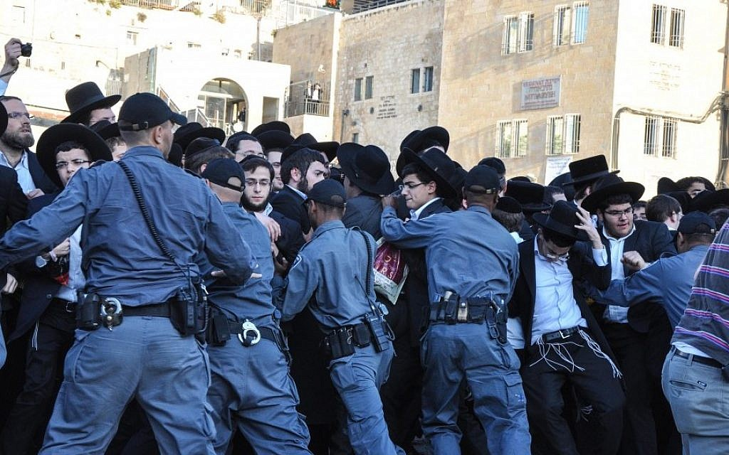 Police kept ultra-Orthodox teens from disturbing last month's Women of the Wall prayer service . Three Haredi men were arrested. (photo credit: Michal Shmulovich/Times of Israel)