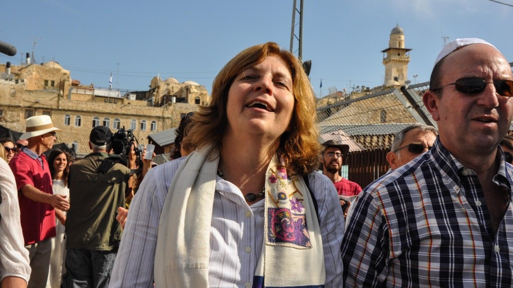 "Anat Hoffman, chair of the Women of the Wall, walks out of the Old City's Dung Gate, free and ""not arrested,"" she noted, as she left the plaza escorted by police for protection (photo credit: Michal Shmulovich/Times of Israel)"