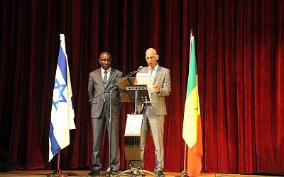 Israel's ambassador to Senegal, Eli Ben-Tura, and Senegalese government minister Mamadou Talla speaking at an Israel Independence Day celebration at Dakar's grand theater, April 30, 2013. (photo credit: Cnaan Liphshiz/JTA)