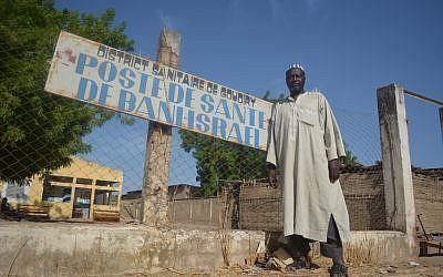 Dougoutigo Fadiga outside the Bani Israel clinic near the Senegalese village's sacred tree, May 2013. (photo credit: Cnaan Liphshiz/JTA)