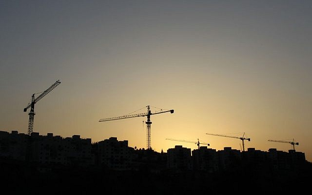 Cranes building new apartment buildings in Beit Shemesh, in 2011. (photo credit: Nati Shohat/Flash90)