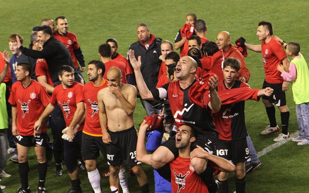 Israel's first fan-owned team, Hapoel Katamon, celebrating a win (photo credit: Yossi Zamir/Flash 90)