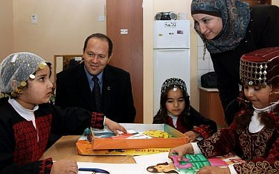 Outgoing Jerusalem Mayor Nir Barkat visits Arab students in a newly opened elementary school in the Arab neighborhood of Umm Tuba, in East Jerusalem, on December 13, 2011. (photo credit: Kobi Gideon/Flash90)
