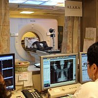 A woman with breast cancer receives a CT scan (Chen Leopold/FLASH90)