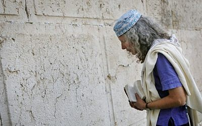 A woman prays at Robinson's Arch, near the Western Wall in Jerusalem, March 12, 2013. (photo credit: Miriam Alster/FLASH90)