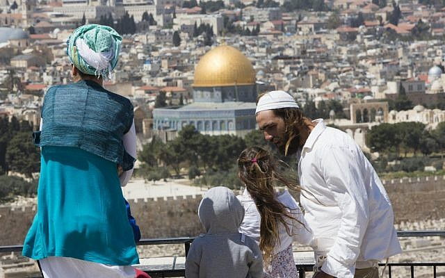 A Jewish family looks out over the Temple Mount, March 2013. (photo credit: Yonatan Sindel/Flash90)