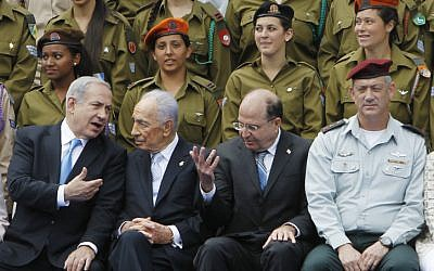 From left, Benjamin Netanyahu, Shimon Peres, Moshe Ya'alon and Benny Gantz at a ceremony in May. (photo credit: Miriam Alster/Flash90)