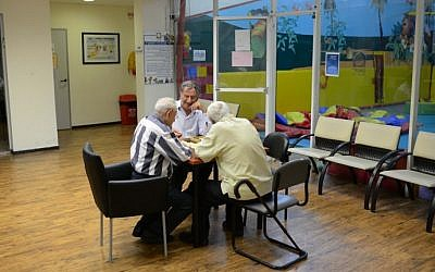Illustrative photo of elderly men playing backgammon at a country club in northern Tel Aviv. (Tomer Neuberg/Flash90)