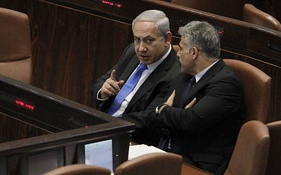 Then finance minister Yair Lapid speaking with Prime Minister Benjamin Netanyahu in the Knesset, May 1, 2013 (Miriam Alster/FLASH90)