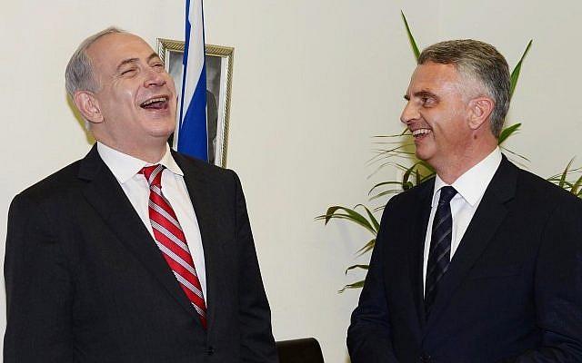 Prime Minister Benjamin Netanyahu (left) meets with Swiss Foreign Minister Didier Burkhalter at the premier's Tel Aviv office on Thursday. (photo credit: Moshe Milner/GPO/Flash90)
