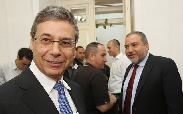 Former deputy foreign minister Danny Ayalon (L) at the Jerusalem Magistrates Court in Jerusalem next to his former boss, Avigdor Liberman, Thursday, May 2, 2013 (photo credit: Yossi Zamir/POOL/Flash90)