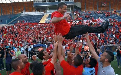 Hapoel Katamon supporters celebrate promotion to the second league Liga Leumit, May 3, 2013. (photo credit: Yossi Zamir/Flash 90)